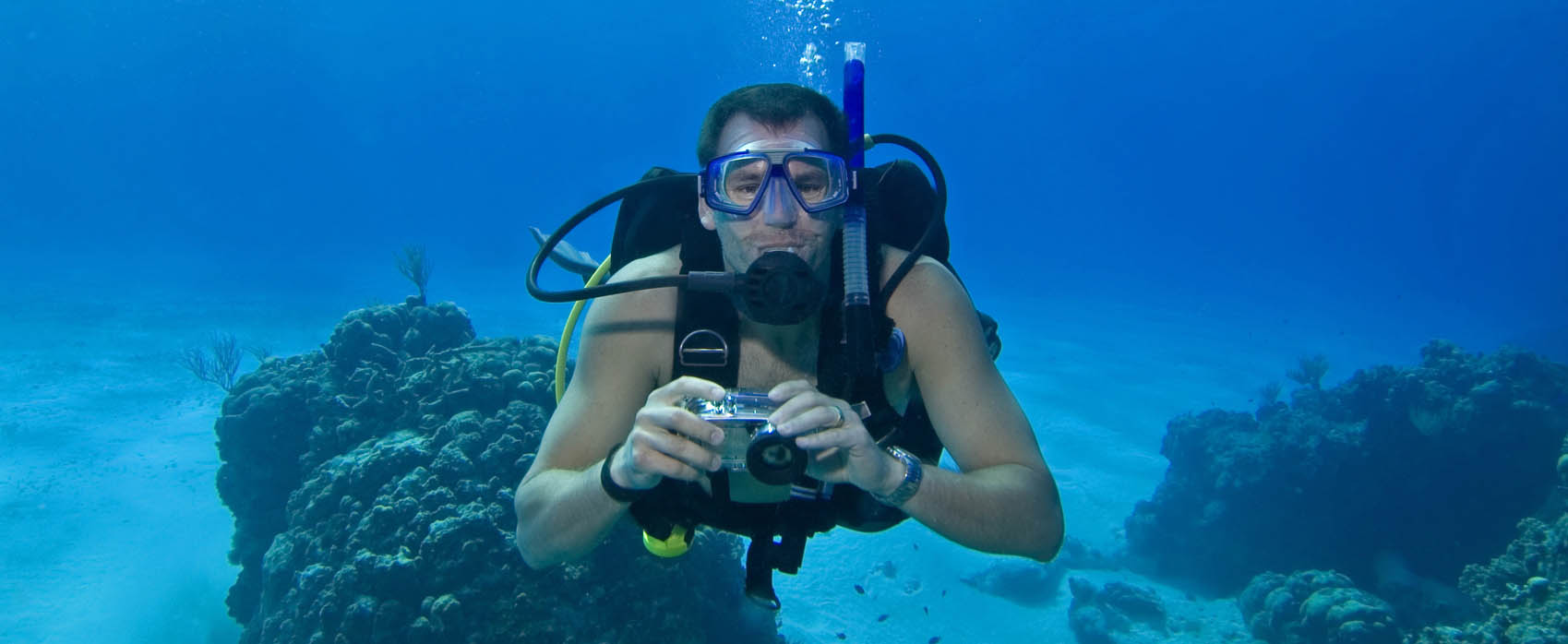 Man scuba diving in Cozumel, Mexico
