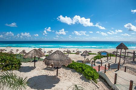 Cancun Beach with palapas